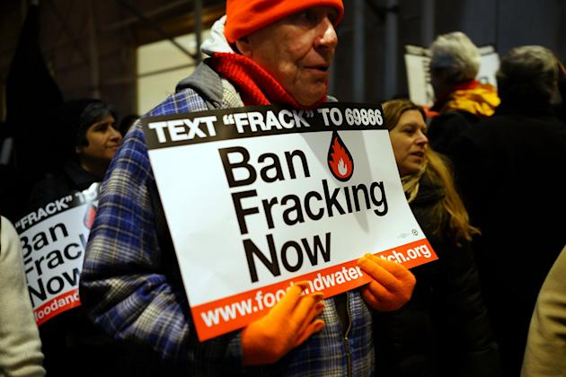 NEW YORK, NY - JANUARY 07: Anti Fracking protesters demonstrate in front of the Waldorf Astoria as New York Gov. Andrew Cuomo visits the hotel for a function on January 7, 2013 in New York City. Fracking, a process that injects millions of gallons of chemical mixed water into a well in order to release gas, has become a contentious issue in New York as critics of the process believe it contaminates drinking water among other hazards. New York City gets much of its drinking water from upstate reservoirs. If the regulations are approved by Governor Cuomo, drilling in the upstate New York Marcellus Shale could later this year. (Photo by Spencer Platt/Getty Images)