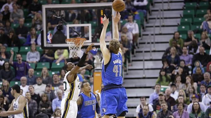 Dallas Mavericks' Dirk Nowitzki (41) shoots as Utah Jazz's Jeremy Evans defends in the second half during an NBA basketball game Wednesday, March 12, 2014, in Salt Lake City. The Mavericks won 108-101
