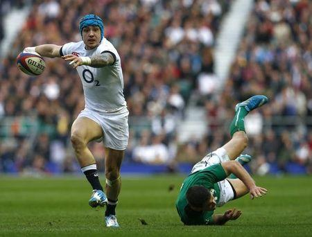 England's Nowell evades a tackle from Ireland's Sexton during their Six Nations Championship rugby union match at Twickenham in London