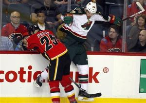 Wild slip past Flames 2-1 in shootout