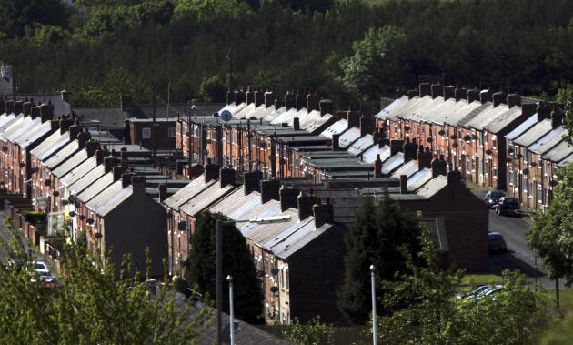 A general view of houses in Grange Villa, England, Tuesday, June 14, 2011. UK House prices look set to continue falling as the hoped-for spring bounce in the property market failed to materialise, research indicated Tuesday. The extended bank holiday weekends in April and early May hit activity levels, while concerns about the economy and the ongoing problems in the mortgage market also affected the number of people looking to move home, according to the Royal Institution of Chartered Surveyors.(AP Photo/Scott Heppell)