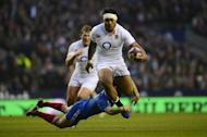England centre Manu Tuilagi breaks through the French defence at Twickenham on February 23, 2013. England coach Stuart Lancaster said there was more to come from his youthful side after they moved closer to a Six Nations Grand Slam with a 23-13 victory over the World Cup finalists,