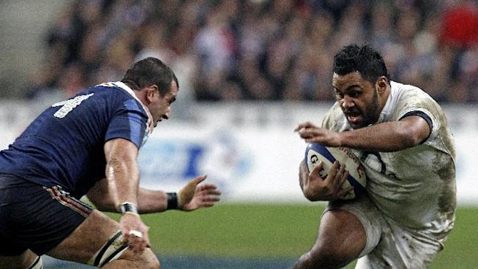 England's Billy Vunipola runs with the ball as France's Yoann Maestri tries to stop him, during their Six Nations rugby union international match, at the Stade de France, in Saint Denis, outside Paris, Saturday, Feb 1, 2014. France defeated England 26-24. (AP Photo/Thibault Camus)