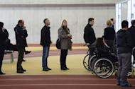 People queue to cast their ballot at a polling station in Reykjavík, Iceland on April 27, 2013. Iceland's centre-right opposition declared victory early Sunday in parliamentary elections, as voters punished the incumbent leftist government for harsh austerity measures during its four years at the helm