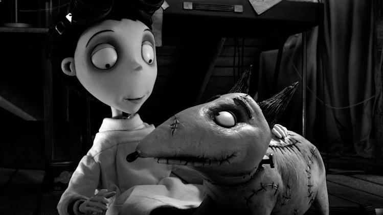 "This film image released by Disney shows Victor Frankenstein, voiced by Charlie Tahan, with Sparky, in a scene from ""Frankenweenie."" (AP Photo/Disney)"
