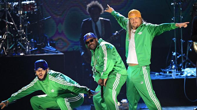"The Roots, including Travie McCoy, left, Tariq ""Black Thought"" Trotter, center and Kid Rock perform after induction of the Beastie Boys into the Rock and Roll Hall of Fame Saturday, April 14, 2012, in Cleveland. (AP Photo/Tony Dejak)"