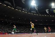Brazil's Alan Oliveira (l) sensationally beats South Africa's Oscar Pistorius (C) in the Men's 200m T44 final at the London 2012 Paralympic Games on September 2. Pistorius apologised Monday for the timing of his outburst after losing his T44 200m title, but insisted there was an issue with large prosthetics lengthening an amputee's stride