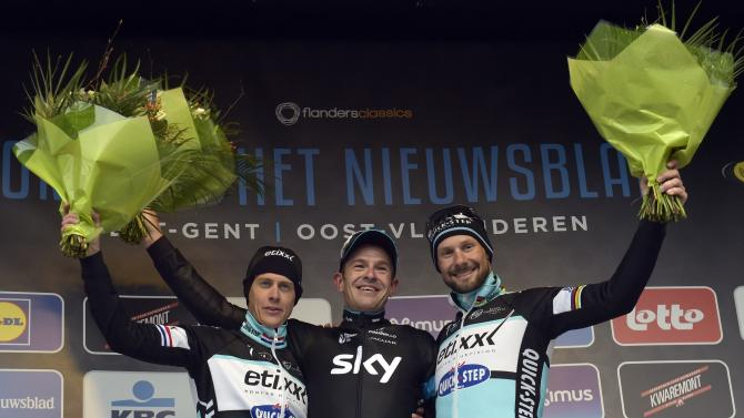 Sky team rider Ian Stannard of Britain celebrates on the podium after winning the Omloop Het Nieuwsblad cycling race in Ghent