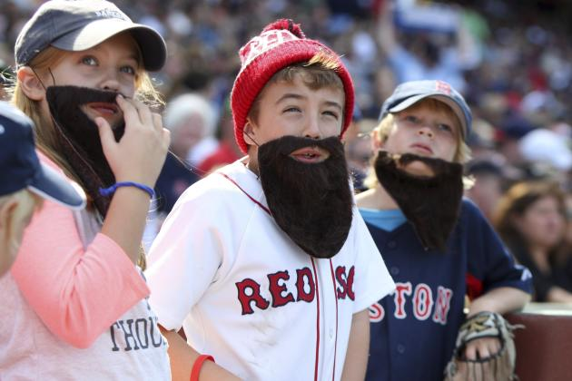 Three fans wear fake beards in support of Red Sox as the team faces the Toronto Blue Jays in their MLB American League East baseball game in Boston