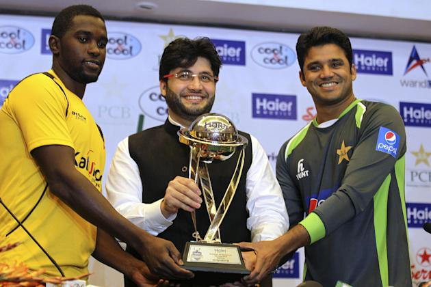 Pakistan's captain of the one-day international cricket team, Azhar Ali, right, Javed Afridi, CEO of Haier Home Appliances, the main sponsor for the ODI series, and Zimbabwe captain Elton Chigumbu