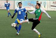 Palestine player Ali Khatib (R), shown on January 14, 2012. FIFA could be about to join the international groups trying to mediate between Israelis and Palestinians, after Khatib, an Arab-Israeli, jumped ship from a Palestinian team to an Israeli one, it was reported on January 26, 2012