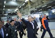 Chinese Prime Minister Wen Jiabao waves to employees at the Volvo car factory in Gothenburg, Sweden, on April 24. China invested a modest $821 million in Poland between 2004-10 with annual averages doubling in recent years, according to a report by the Central & Eastern Europe Development Institute