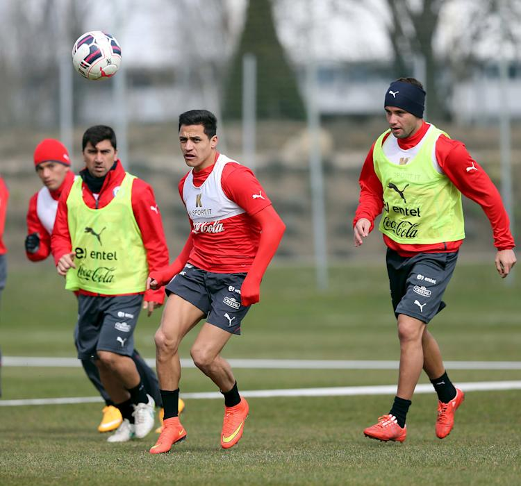 Chile's national soccer player Charles Aranguiz, David Pizarro, Alexis Sanchez and Eugenio Mena attend a training session at St. Polten