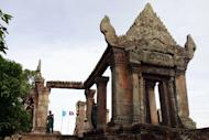 Cambodian police officials are seen standing outside the Preah Vihear temple, on July 18, 2012. Thailand and Cambodia are to face off at the UN's highest court on Monday in a dispute over land surrounding the temple that has seen deadly clashes along their joint border