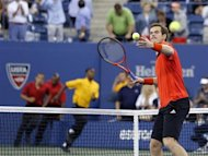 Security runs onto the court as Andy Murray of Britain hits a ball into the crowd to celebrate defeating Denis Istomin of Uzbekistan at the U.S. Open tennis championships in New York September 3, 2013. REUTERS/Shannon Stapleton