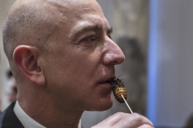 Amazon CEO Jeff Bezos samples cooked cockroach at the Explorers Club Annual Dinner. (Reuters)