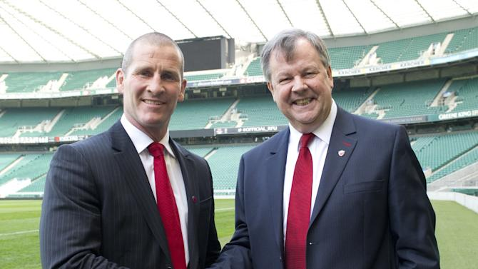 Stuart Lancaster (L), the new head coach of England's rugby union team and Ian Ritchie, Rugby Football Union (RFU) chief executive, pose for photographers before a press conference in Twickenham stadium in south west London on March 29, 2012. Lancaster has been confirmed as the head coach of England following his team's successful Six Nations campaign, the Rugby Football Union (RFU) announced. AFP PHOTO/MIGUEL MEDINA (Photo credit should read MIGUEL MEDINA/AFP/Getty Images)