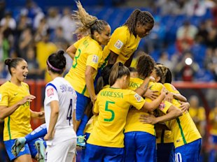 MONTREAL, QC - JUNE 09:  Marta #10 of Brazil celebrates a goal on a penalty kick with teammates in the second half during the 2015 FIFA Women's World Cup Group E match against Korea Republic at Olympic Stadium on June 9, 2015 in Montreal, Quebec, Canada. (Photo by Minas Panagiotakis/Getty Images)