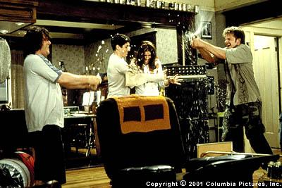Judith ( Amanda Peet , center) gets caught in the crossfire of a suds war between J.D. ( Jack Black , left), Darren ( Jason Biggs , center) and Wayne ( Steve Zahn ) in Columbia's Saving Silverman