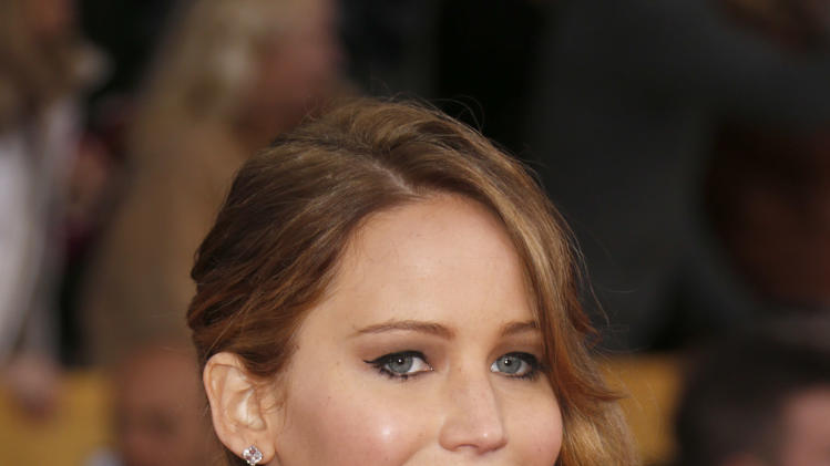 Jennifer Lawrence arrives at the 19th Annual Screen Actors Guild Awards at the Shrine Auditorium in Los Angeles on Sunday Jan. 27, 2013. (Photo by Todd Williamson/Invision for The Hollywood Reporter/AP Images)