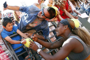Williams of the U.S. poses for a selfie with a supporter as she signs on a ball, after winning the women's singles final match against Errani of Italy, at the Rome Masters tennis tournament