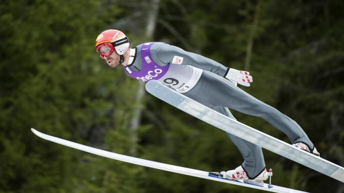 Bieler of Austria soars through the air during the WC Nordic combined competition in Trondheim