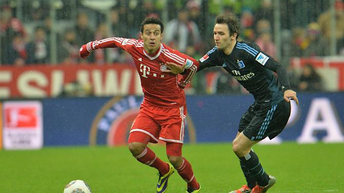 Bayern's Thiago Alcantara of Spain, left, and Hamburg's Milan Badelj challenge for the ball   during  the German first division Bundesliga soccer match between FC Bayern Munich and Hamburger SV  in Munich, Germany, Saturday, Dec. 14, 2013