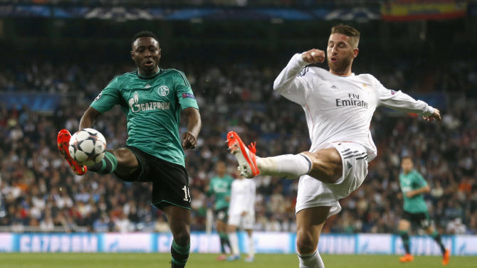 Real Madrid's Ramos kicks the ball past Schalke 04's Obasi during their Champions League last 16 second leg soccer match at Santiago Bernabeu stadium in Madrid