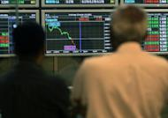 Investors monitor stock market prices in Kuala Lumpur, 2009. Asian markets mostly fell Friday as weak Chinese trade data reinforced concerns of a slowdown in the world's number two economy, while profit-taking after a week-long rally added to selling pressure