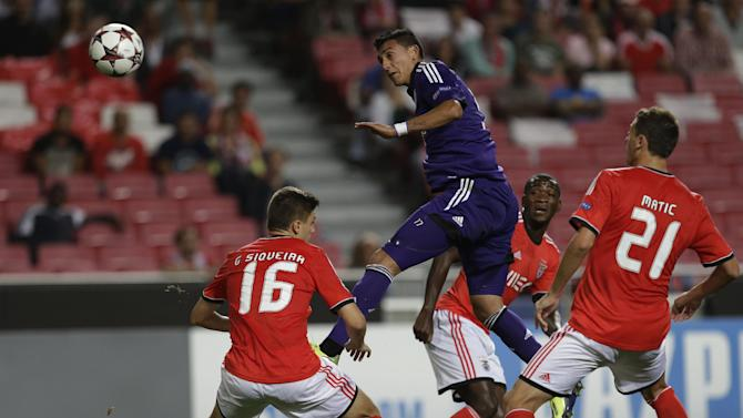 Anderlecht's Matias Suarez, centre jumps to head the ball during the Champions League group C soccer match between Benfica and Anderlecht Tuesday, Sept. 17, 2013, at Benfica's Luz stadium in Lisbon