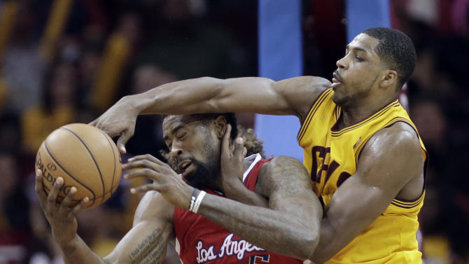 Cleveland Cavaliers' Tristan Thompson, right, from Canada, puts pressure on Los Angeles Clippers' DeAndre Jordan during the fourth quarter of an NBA basketball game on Saturday, Dec. 7, 2013, in Cleveland. The Cavaliers won 88-82