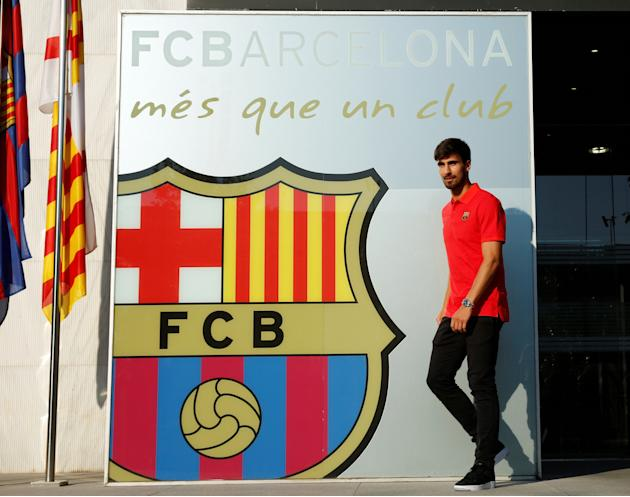 Soccer player Andre Gomes arrives to pose next to a FC Barcelona's giant logo at their offices in Barcelona