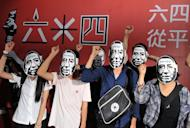 """Students wear Liu Xiaobo masks at a Tienanmen massacre commemoration in Taipei on June 4. Liu Xiaobo was jailed in 2009 for """"subversion"""" after he circulated a charter calling for democratic reforms"""
