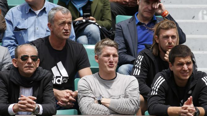 Bayern Munich's soccer player Bastian Schweinsteiger watches the women's quarter-final match between Ana Ivanovic of Serbia and Elina Svitolina of Ukraine during the French Open tennis tournament in Paris