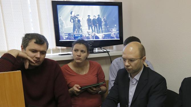 Plaintiffs present video of a Madonna concert during a court hearing in St. Petersburg, Russia, Thursday, Nov. 22, 2012. The court is considering an appeal by Russian activists who claimed that Madonna was promoting homosexuality in violation of a local law. (AP Photo/Dmitry Lovetsky)