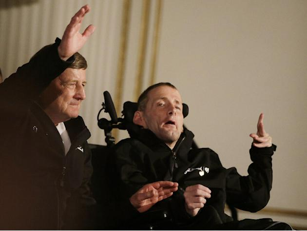 Father and son Boston Marathon race team Dick, left,  and Rick Hoyt wave as they are introduced during a media availability of Boston Marathon elite runners at the Copley Plaza Hotel in Boston Friday