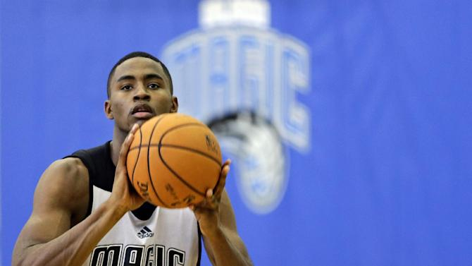 Orlando Magic's Maurice Harkless (21) works on his shooting during NBA basketball training camp, Tuesday, Oct. 1, 2013, in Orlando, Fla