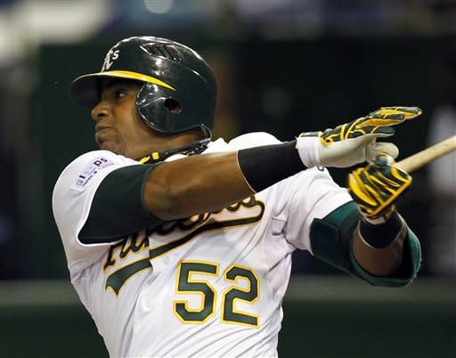 Cespedes' 1st big league HR leads A's over M's 4-1