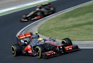 Lewis Hamilton (foreground) and Kimi Raikkonen drive at the Hungaroring circuit. Hamilton confirmed that he and McLaren have recovered their form when he swept to a dominant pole position in Saturday's closely-fought qualifying session for Sunday's Hungarian Grand Prix