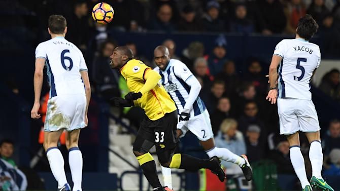 Watford's Stefano Okaka in action with West Bromwich Albion's Jonny Evans (L) and Allan Nyom