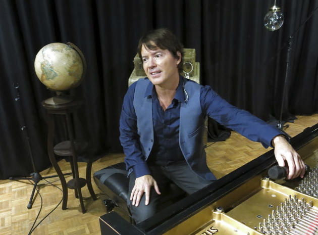 In this June 23, 2015 photo, American pianist and songwriter Arthur Hanlon showcases songs from his upcoming album, yet to be titled, during a presentation at a Sony Music recording studio in Naucalpa