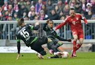 Bremen's defenders Theodor Gerbe Selassie and Sebastian Proedl (L) chalenge Bayern Munich's midfielder Franck Ribery (R) during their German first division Bundesliga football match in the southern German city of Munich on February 23, 2013. Bayern Munich rested half a dozen stars but still romped to a 6-1 win at home to 10-man Werder Bremen to go 18 points clear at the top of the Bundesliga