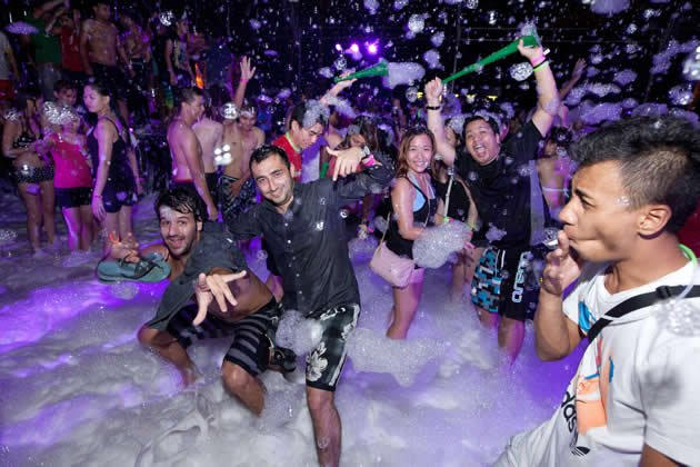 Thousands frolicked in foam at the Siloso Beach Countdown Party 2012. (Yahoo! photo)