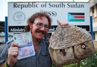 Graham Hughes, 33, a Briton, celebrated Monday claiming to be the first person to have visited every sovereign nation on the globe without flying, after he crossed into the world's youngest country, South Sudan