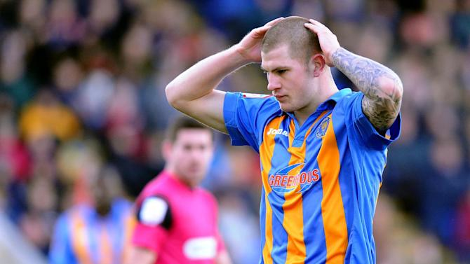 Shrewsbury will be entitled to compensation should James Collins join Swindon