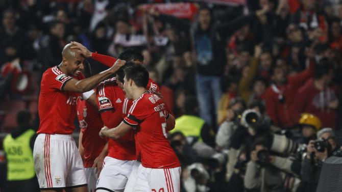 Benfica's Enzo Perez celebrates his goal against Sporting with Luisao and Nicolas Gaitan during their Portuguese Premier League soccer match at Luz stadium in Lisbon
