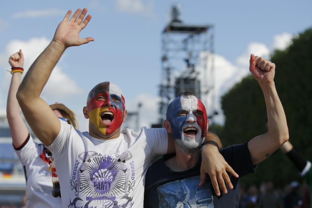 Fans reacts after Germany goal as they watch a EURO 2016 Round of 16 soccer match in Paris
