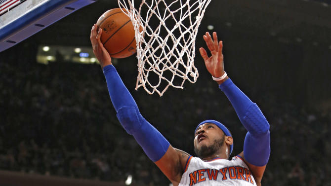 New York Knicks' Carmelo Anthony (7) goes to the basket against the Miami Heat during the first half of an NBA basketball game Saturday, Feb. 1, 2014, in New York. (AP Photo/Jason DeCrow)