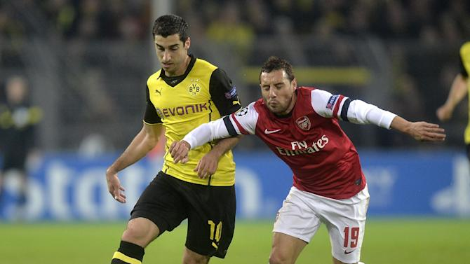 Dortmund's Henrikh Mkhitaryan, left, and Arsenal's Santi Cazorla challenge for the ball during the Champions League group F soccer match between Borussia Dortmund and Arsenal FC in Dortmund, Germany, Wednesday, Nov. 6, 2013