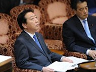 Japan's Prime Minister Yoshihiko Noda (left) and Deputy Prime Minister Katsuya Okada attend an upper house special committee session at the parliament in Tokyo. A bill to double Japan's sales tax and partially plug its gaping debt hole cleared its final parliamentary hurdle in a triumph for the prime minister that could ultimately also cost him his job